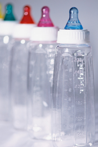 Clear bottles with colored nipples