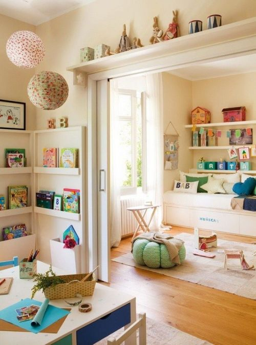 playroom with built-in shelves, cozy bench, and soft colors