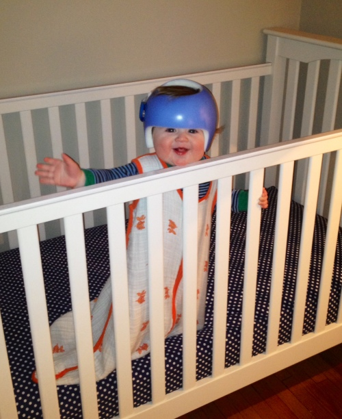 A picture of Will standing up in his crib