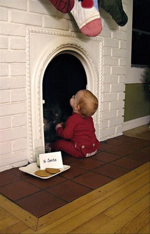 Christmas card with baby look up the chimney