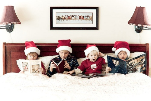 chritmas card of kids reading in bed